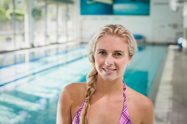 Attractive woman standing next to the pool Premium Photo