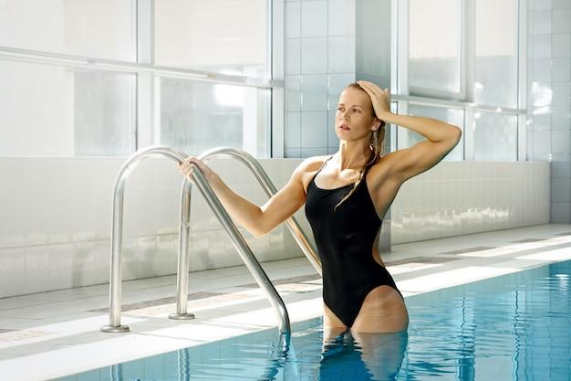 Attractive woman swimmer Premium Photo