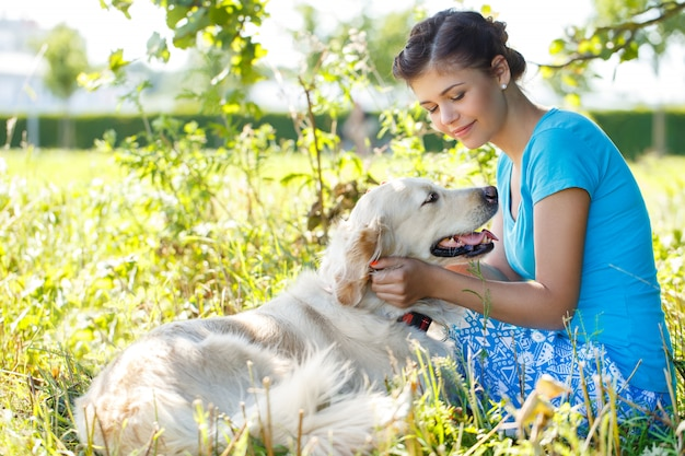 Attractive woman with dog Free Photo