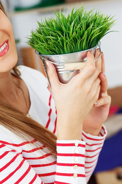Attractive woman with grass with pot Free Photo