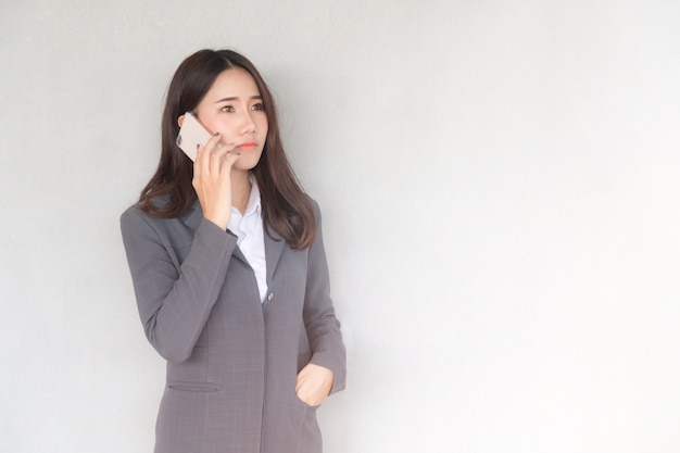 Attractive young asian businesswoman making a phone call. Premium Photo