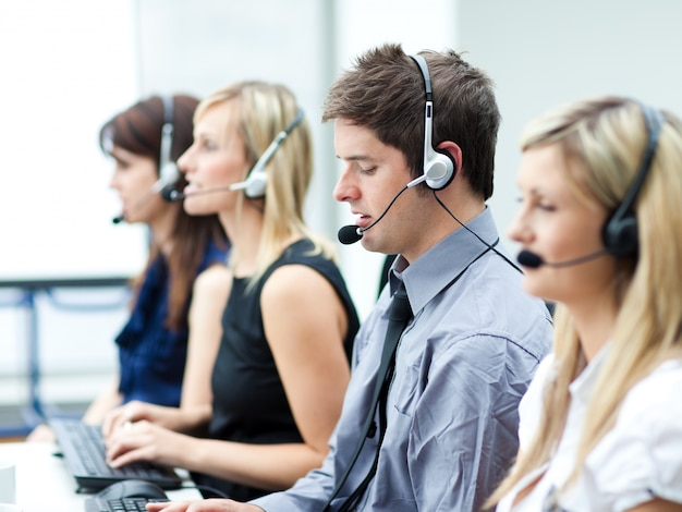 Attractive young man working in a call center Premium Photo