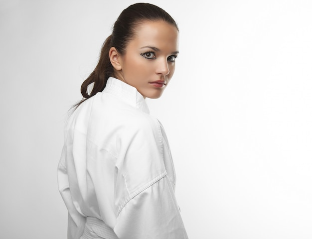Attractive young sexy women in a karate pose Premium Photo
