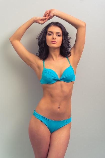 Attractive young woman in blue underwear. Premium Photo
