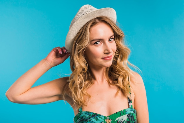 Attractive young woman in flowered dress and hat Free Photo