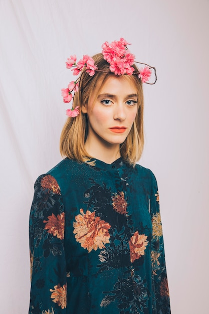 Attractive young woman with flower wreath on head Free Photo