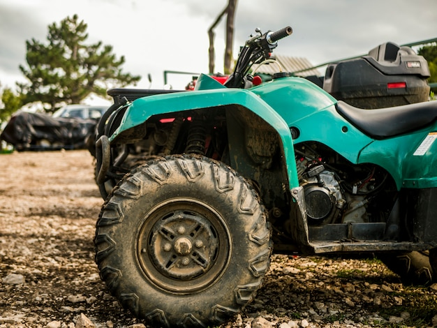 Atv in a mountain parking zone on a rainy summer day Premium Photo