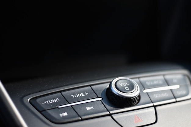 Audio control in a car with a black background for copy space Premium Photo