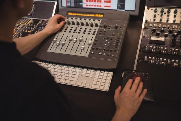 Audio engineer using sound mixer Free Photo