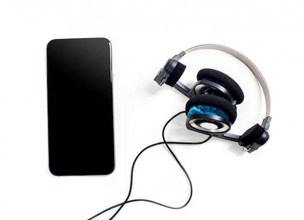 Audio player with headphones isolated on white surface Premium Photo