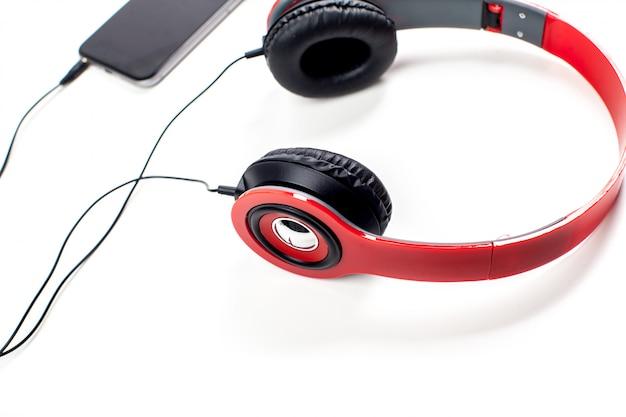 Audio player with headphones isolated on white Premium Photo
