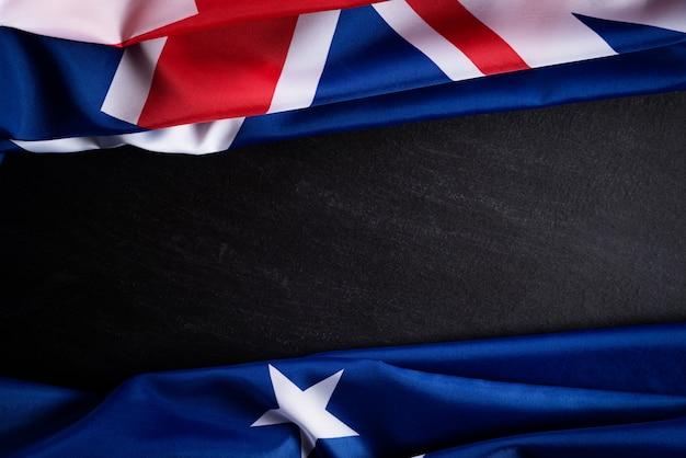 Australia day concept. australian flag against a blackboard background Premium Photo