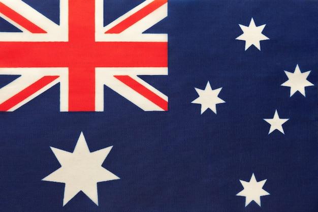 Australia national fabric flag, textile background. symbol of international world country. Premium Photo