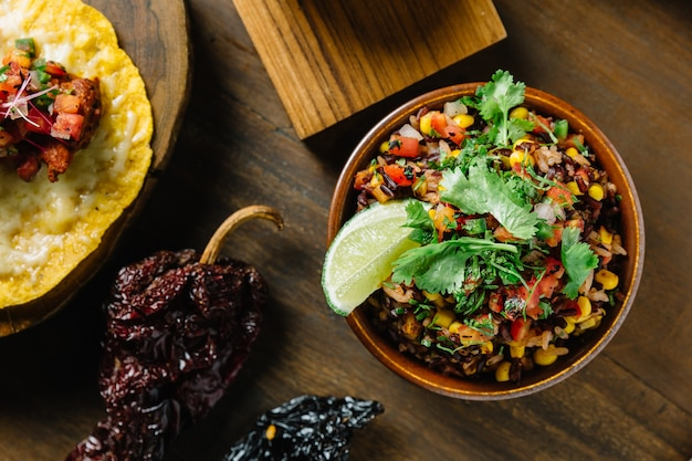 Authentic mexican rice (arroz rojo) mix with rice berry, tomato and corn. Premium Photo
