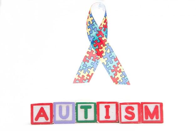 Autism Awareness Ribbon Above Letter Blocks Spelling Autism Photo