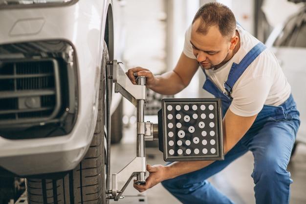 Auto mechanic checking car Free Photo