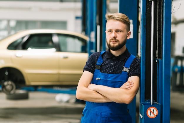 Auto mechanic crossing hands Free Photo