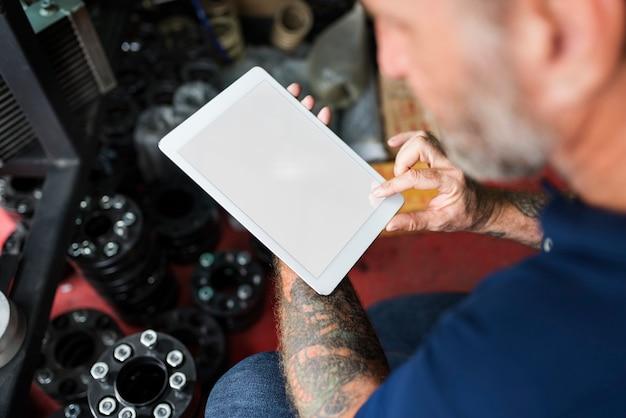 Auto repair shop owner checking tablet concept Premium Photo