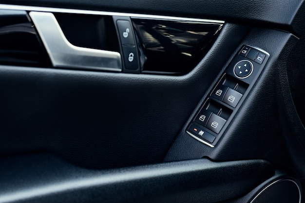 Automatic control panel of car windows close up Premium Photo