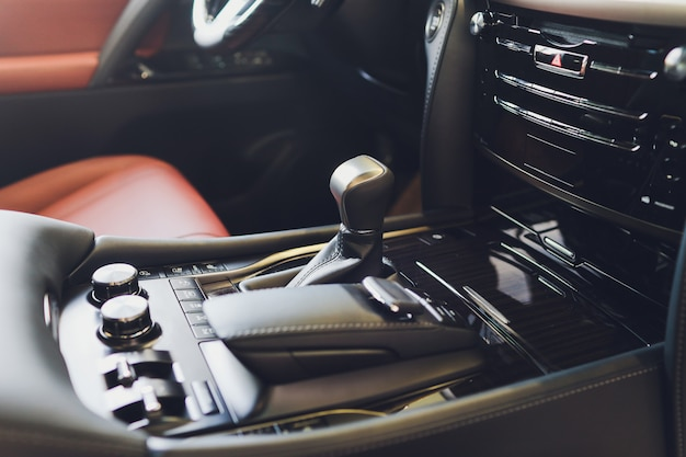 Automatic gear stick transmission of a modern car, multimedia and navigation control buttons. car interior details. transmission shift. Premium Photo