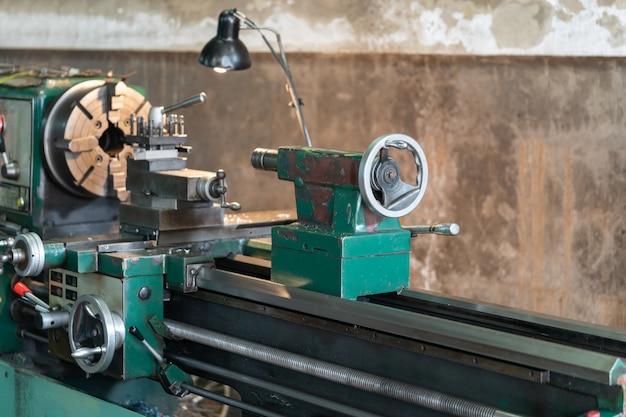 Automotive rotating parts -  metal lathe is a tool that rotates the workpiece Premium Photo