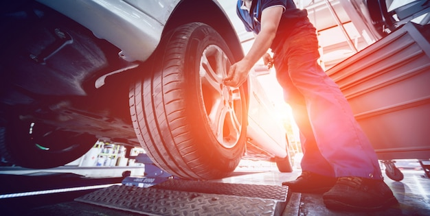 Automotive suspension test and brake test rolls in a auto repair service. Premium Photo