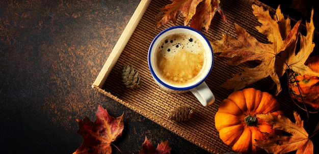 Autumn arrangement with coffee and pumpkin Premium Photo