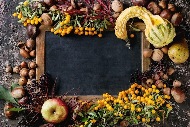 Autumn berries with chalkboard Premium Photo