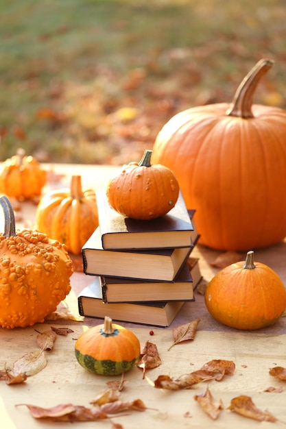 Autumn books. halloween books. stack of books and  pumpkins Premium Photo