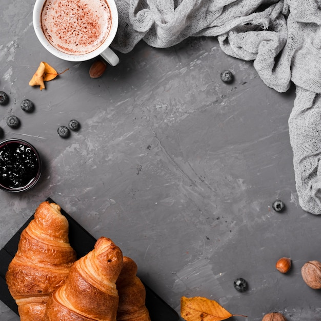 Autumn breakfast with croissants and coffee Free Photo