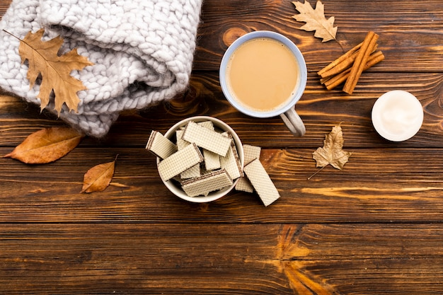 Autumn coffee and wafers layout on wooden background Free Photo