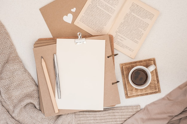 Autumn composition. cup of coffee, book, blanket, notebook, women fashion sweater. Premium Photo