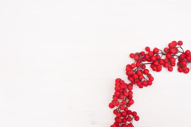 Autumn composition. wreath made of rowan berries. Premium Photo