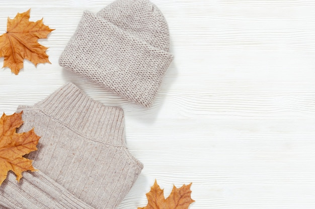 Autumn flat lay with warm clothing. fashion clothes for womans Premium Photo