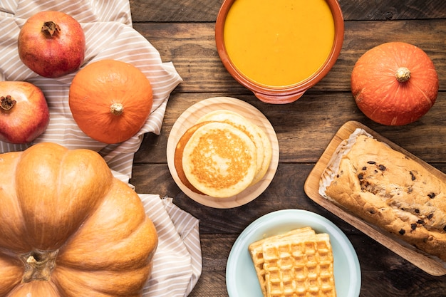 Autumn food on striped sheet and wooden background Free Photo