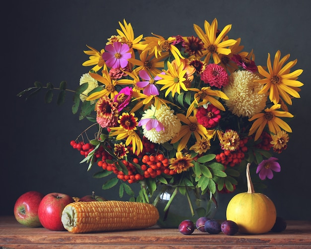 Autumn Garden Flowers In Jug Fruit And Vegetables On The Table
