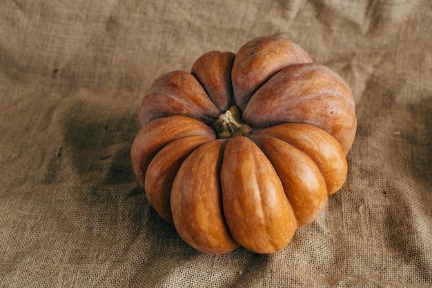 Autumn harvest. pumpkins on burlap. Premium Photo