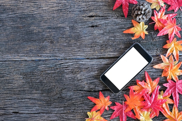Premium Photo Autumn Leaves And Mockup Mobile Phone On Wooden Nature Background With Copy Space