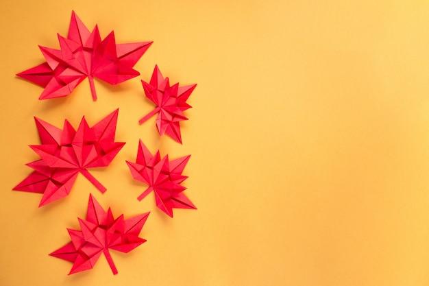 Autumn maple leaves on orange Premium Photo