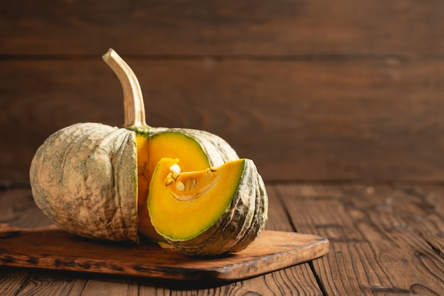 Autumn pumpkin on wooden table. Free Photo