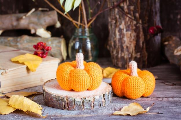 Autumn still life with a pumpkin and fallen leaves Premium Photo