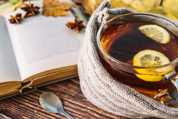 Autumn tea with open book Free Photo