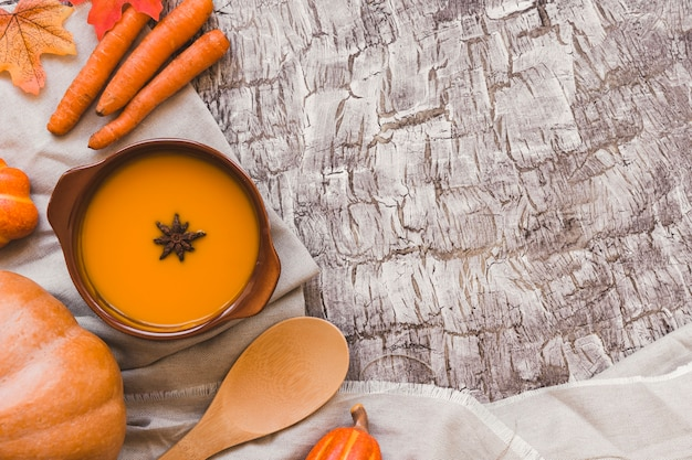 Autumn vegetables near soup and soon Free Photo