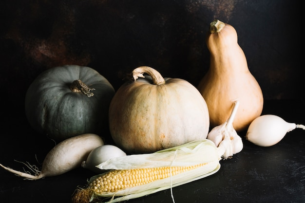 Autumn veggies assortment with pumpkin and corn Free Photo