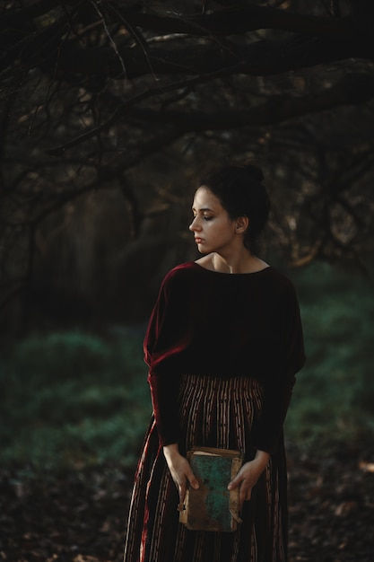Autumn vibes. gothic style. brunette woman in dark red cloth Free Photo