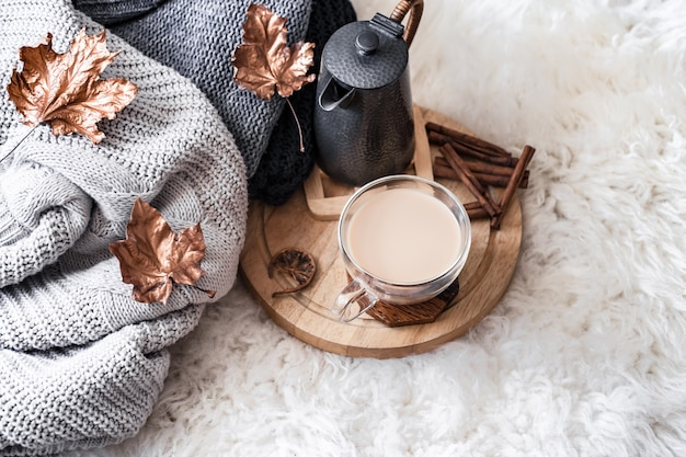Autumn-winter cozy home still life with a cup of hot drink. Free Photo