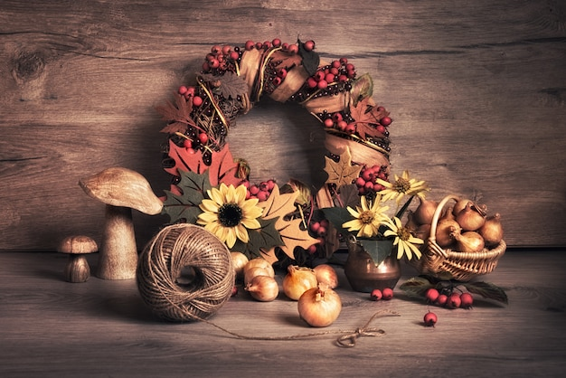 Autumn wreath and still life with mushrooms and onions Premium Photo