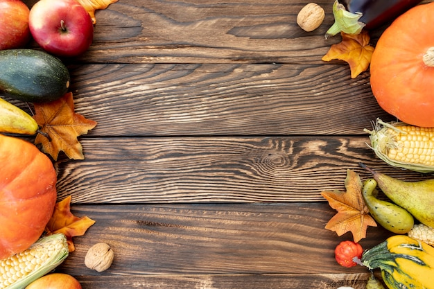 Autumnal frame on wooden table with copy space Free Photo