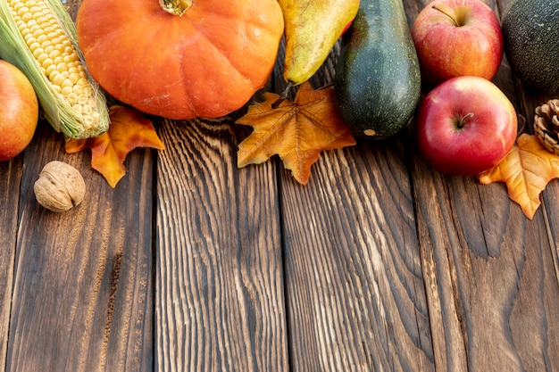 Autumnal frame on wooden table Free Photo