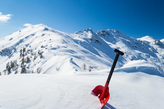 Avalanche shovel in the snow Premium Photo